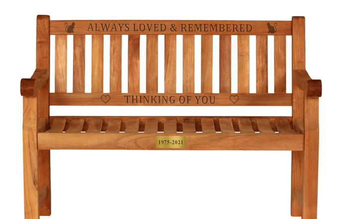 carved words on a wooden memorial bench
