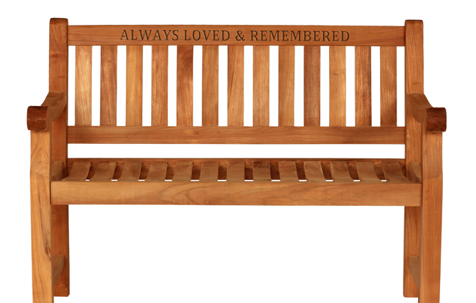 wood carving message on a memorial bench