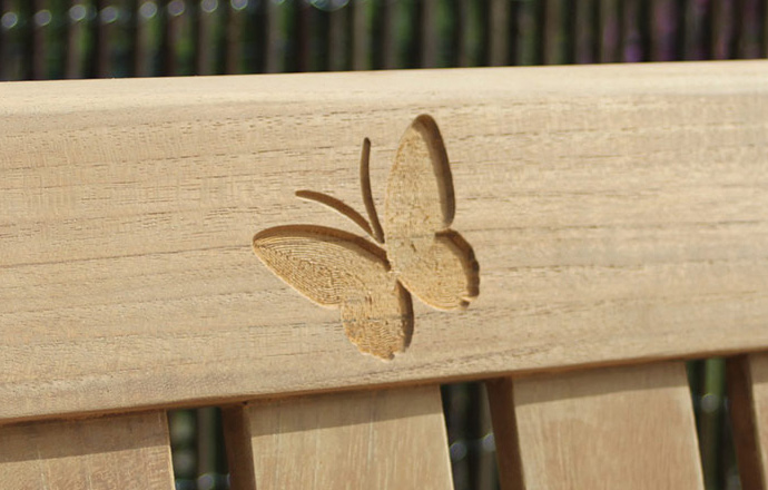 engraved-images-carved-into-wooden-bench