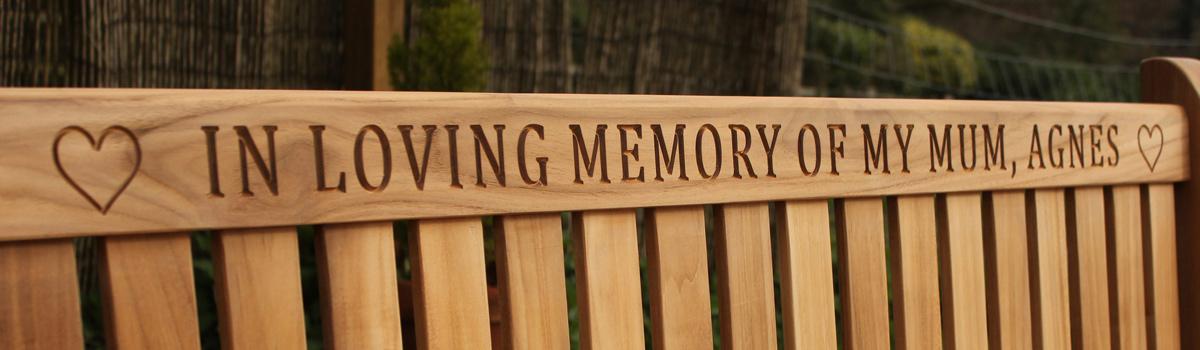 wooden engraving on a memorial bench